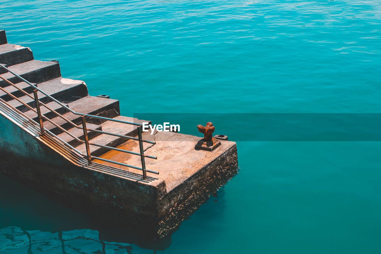 High Angle View Of Steps Over Sea