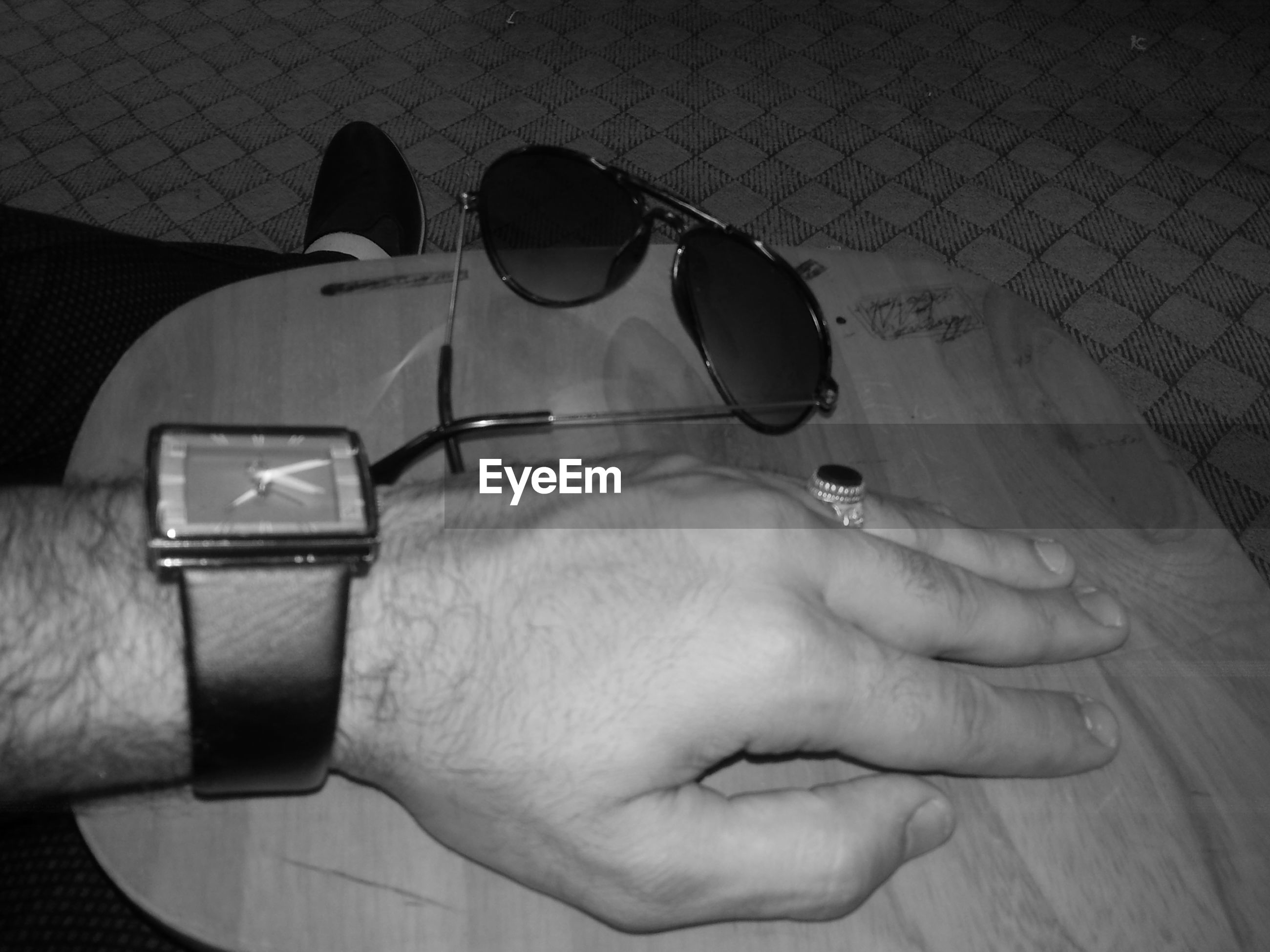person, part of, holding, lifestyles, men, cropped, unrecognizable person, leisure activity, personal perspective, human finger, close-up, indoors, high angle view, technology, day
