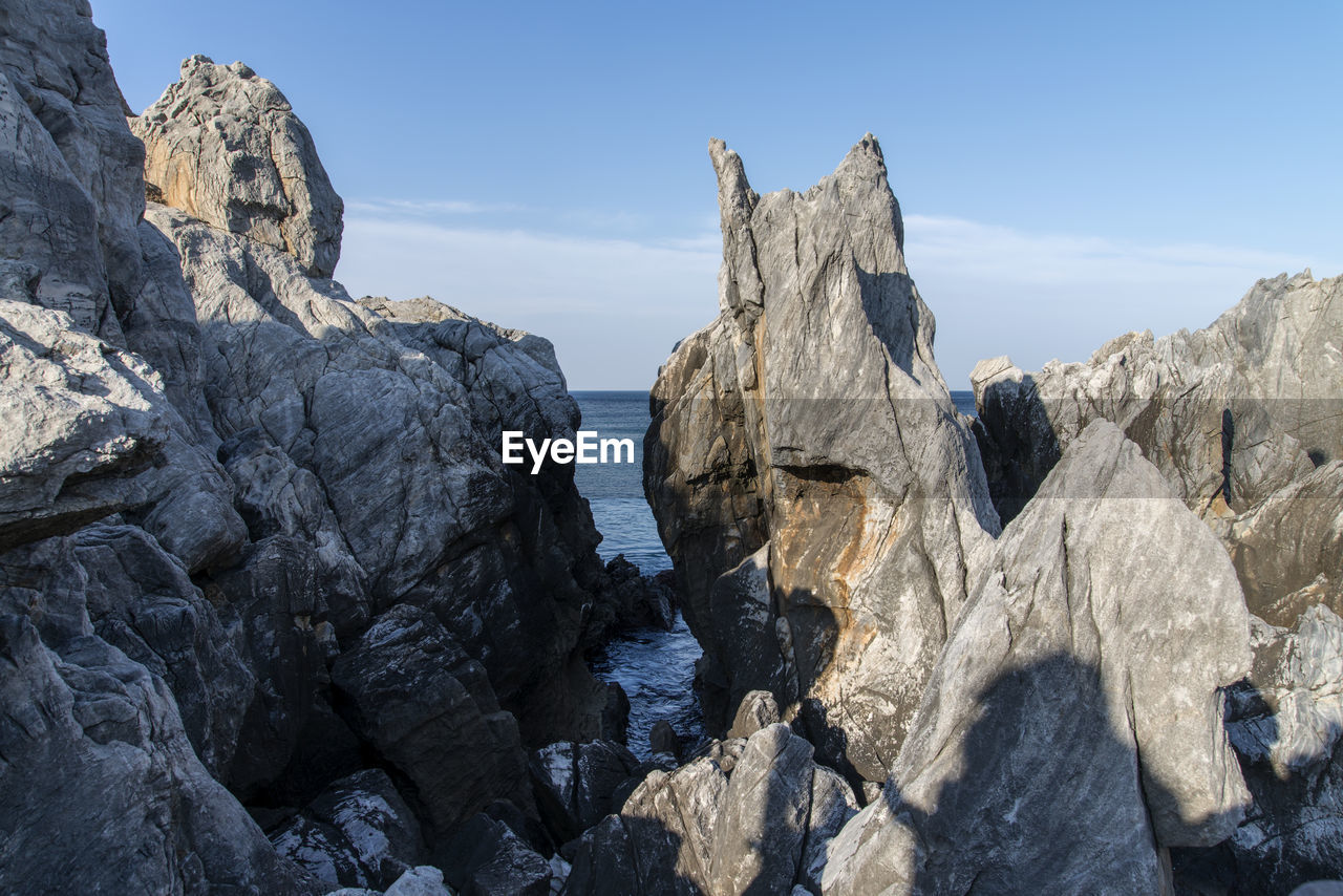 Rock Formations Against Sky At Chuam Beach