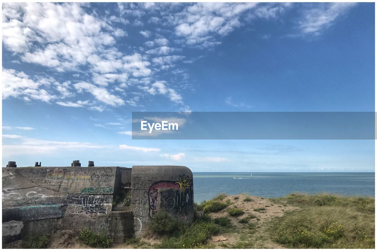 sea, horizon over water, sky, cloud - sky, day, water, nature, no people, scenics, outdoors, architecture, built structure, beauty in nature, tranquil scene, old ruin, tranquility, building exterior, beach