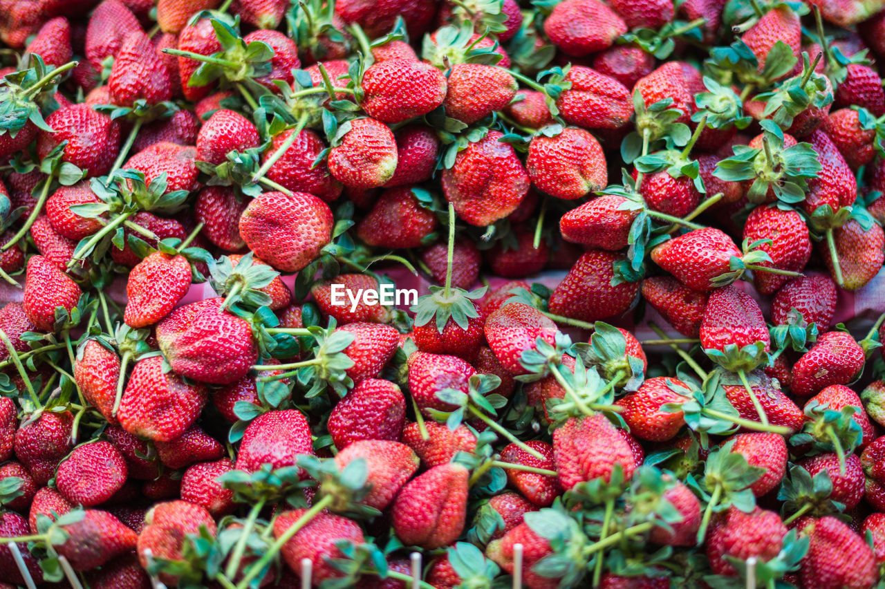 Full frame shot of strawberries for sale at market stall
