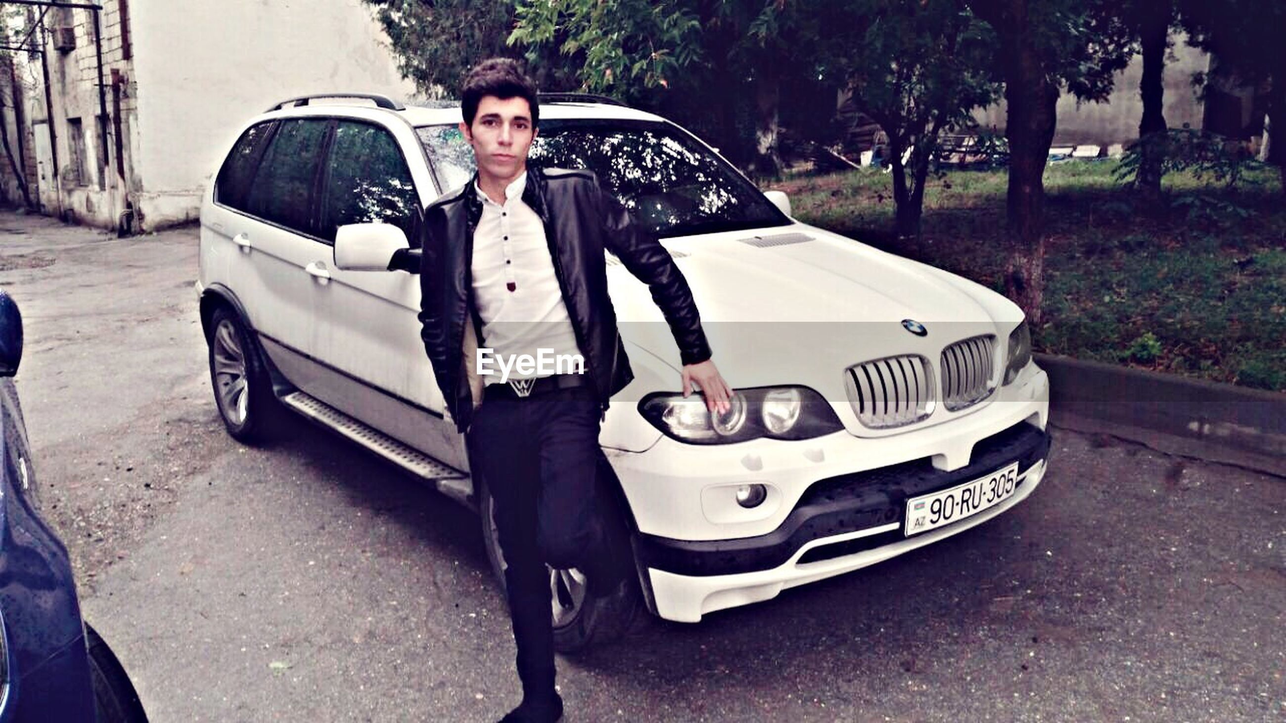 transportation, mode of transport, land vehicle, car, lifestyles, leisure activity, street, road, front view, travel, young adult, sunglasses, casual clothing, sunlight, day, young men, person, outdoors