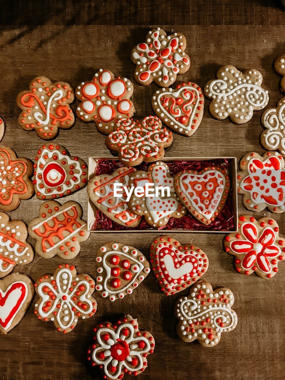 food, food and drink, no people, cookie, sweet food, indoors, baked, freshness, still life, sweet, celebration, directly above, red, icing, high angle view, holiday, wood - material, heart shape, large group of objects, decoration, gingerbread cookie, snack, temptation