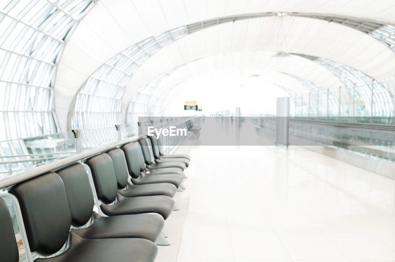 Empty seats in airport building