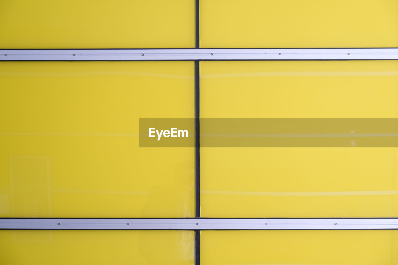 yellow, no people, full frame, architecture, wall - building feature, backgrounds, vibrant color, indoors, close-up, pattern, built structure, multi colored, day, in a row, side by side, copy space, order, orange color, business