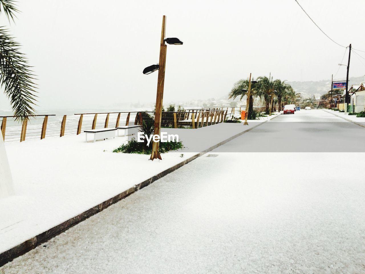 Frozen Street Against Sky During Winter