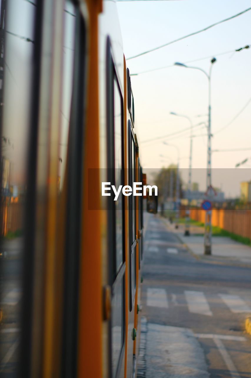 transportation, public transportation, mode of transport, rail transportation, train - vehicle, selective focus, land vehicle, no people, sky, outdoors, day, close-up