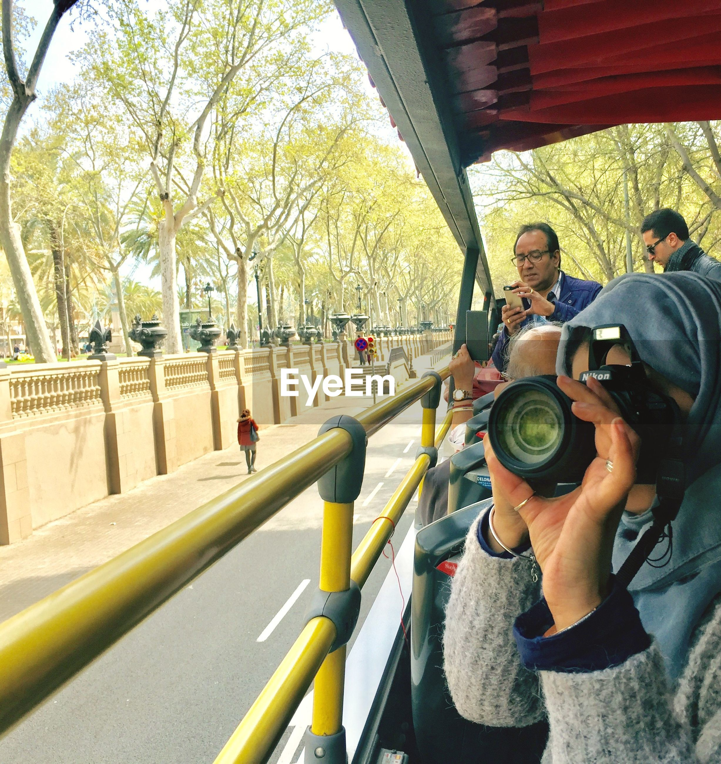 PORTRAIT OF PEOPLE PHOTOGRAPHING ON BUS