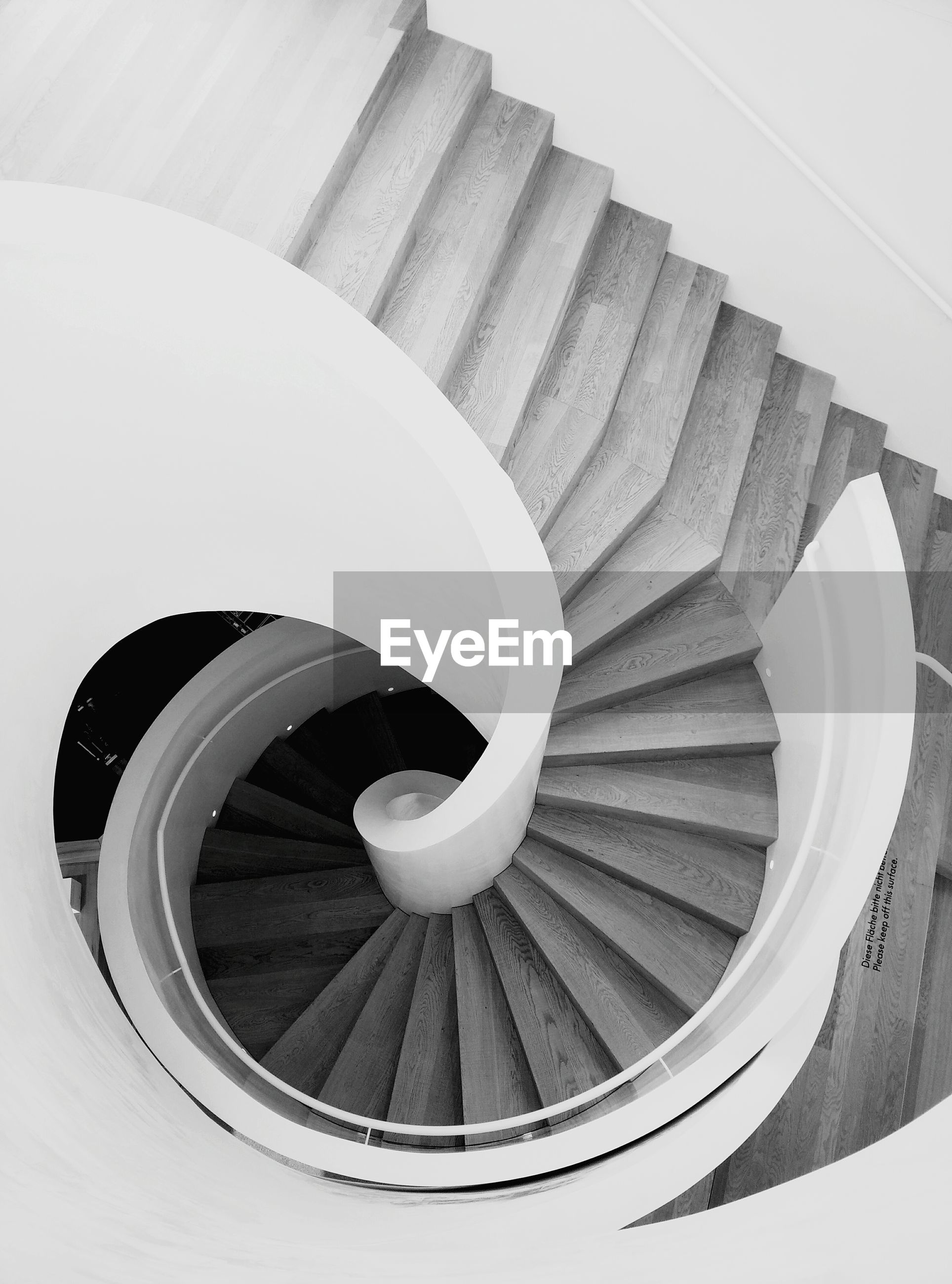 steps and staircases, spiral staircase, staircase, spiral, steps, railing, built structure, circle, architecture, high angle view, indoors, directly above, geometric shape, pattern, white color, building, metal, close-up, shape, stairs