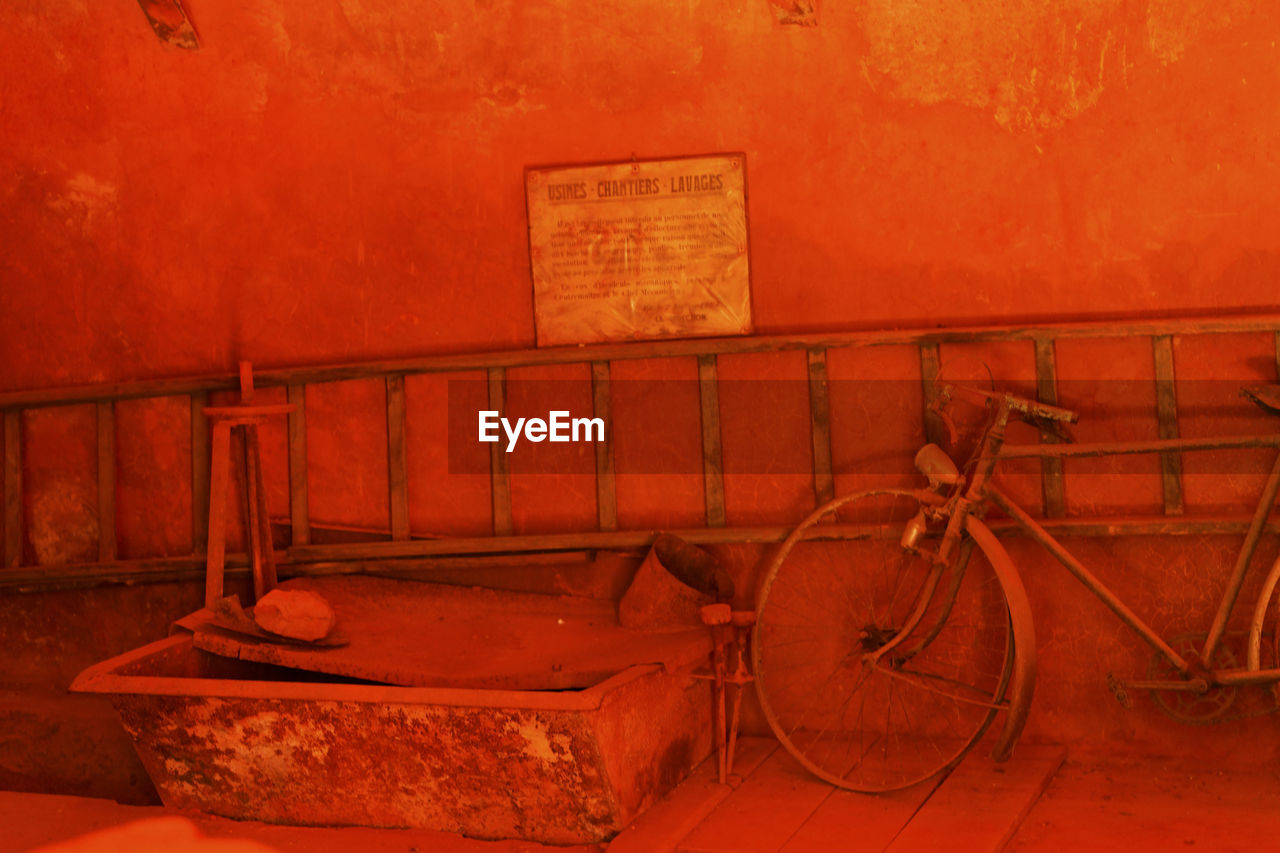 OLD RUSTY BICYCLE BY WALL