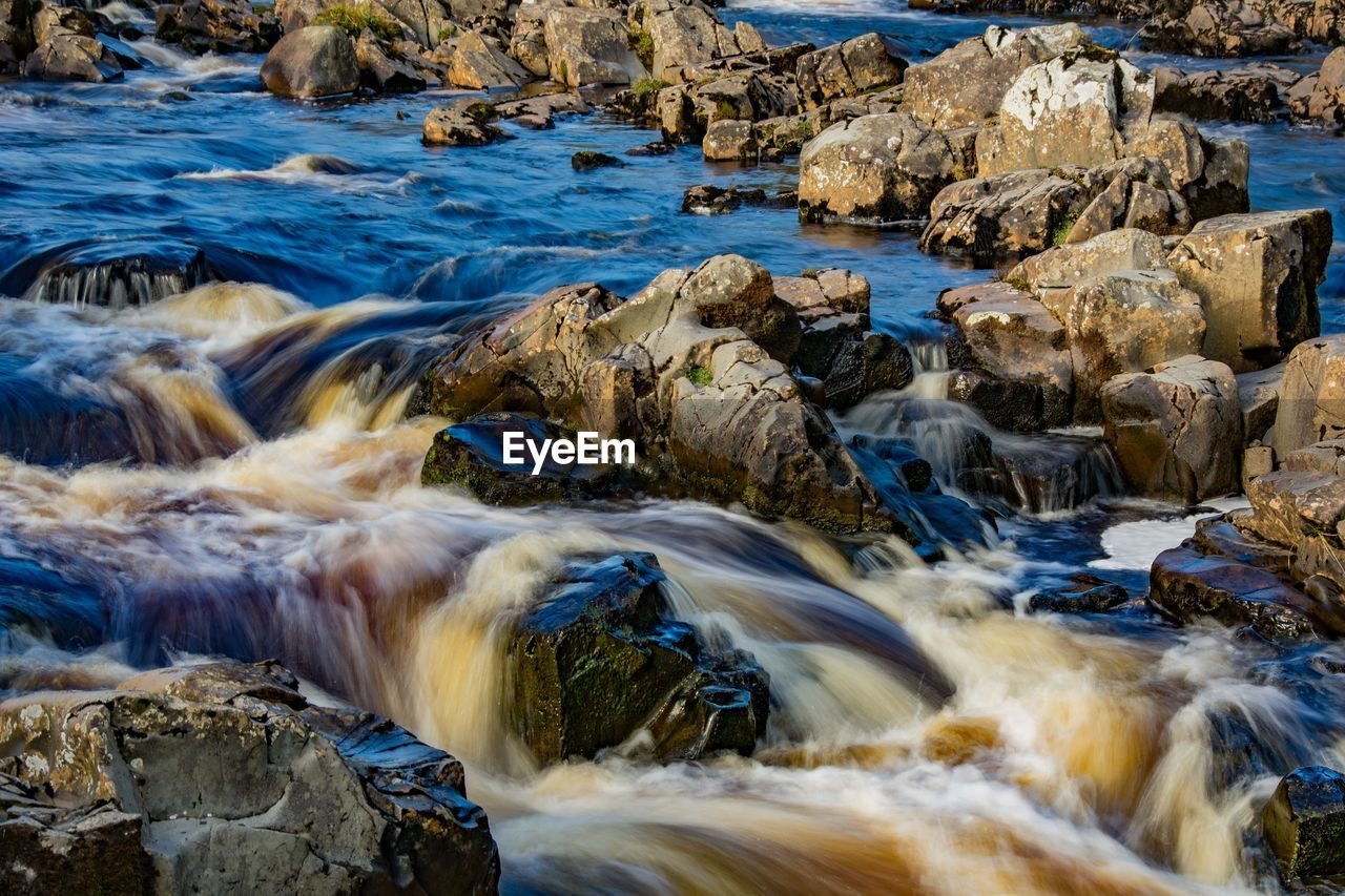 water, rock, solid, motion, rock - object, sea, blurred motion, flowing water, beauty in nature, no people, nature, long exposure, day, land, scenics - nature, flowing, aquatic sport, sport, outdoors, stream - flowing water, power in nature, running water