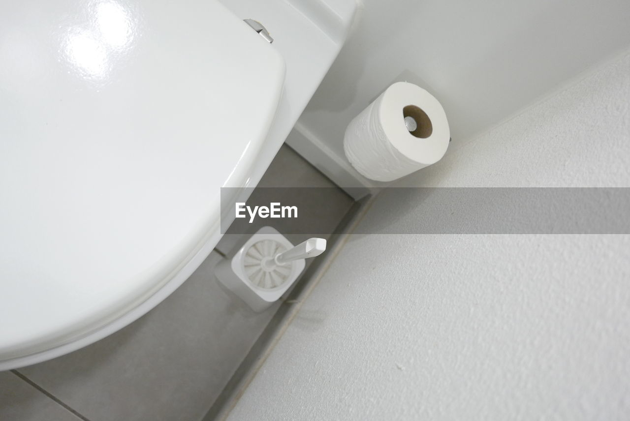 High angle view of brush and paper in toilet