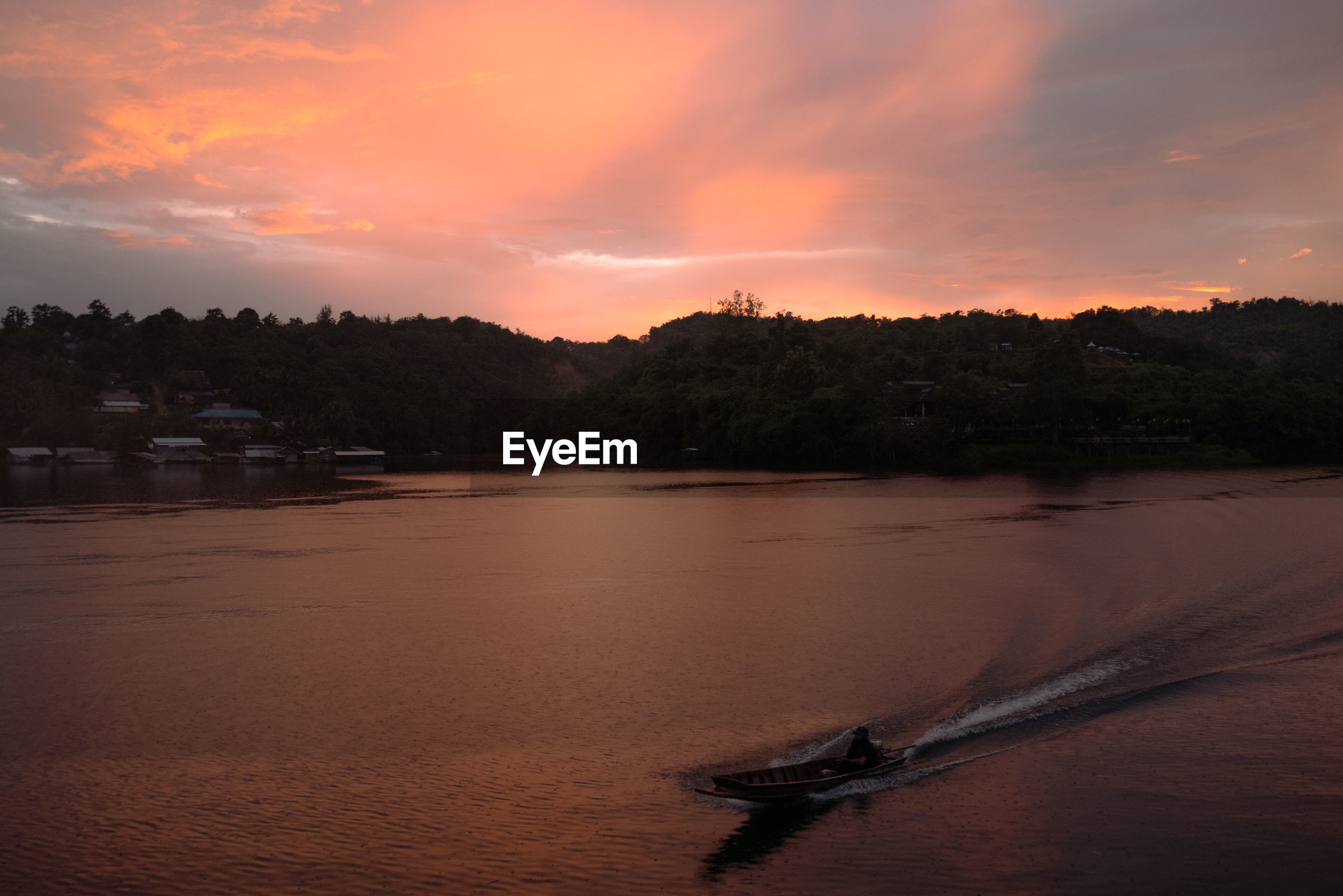 SCENIC VIEW OF RIVER AGAINST ORANGE SKY