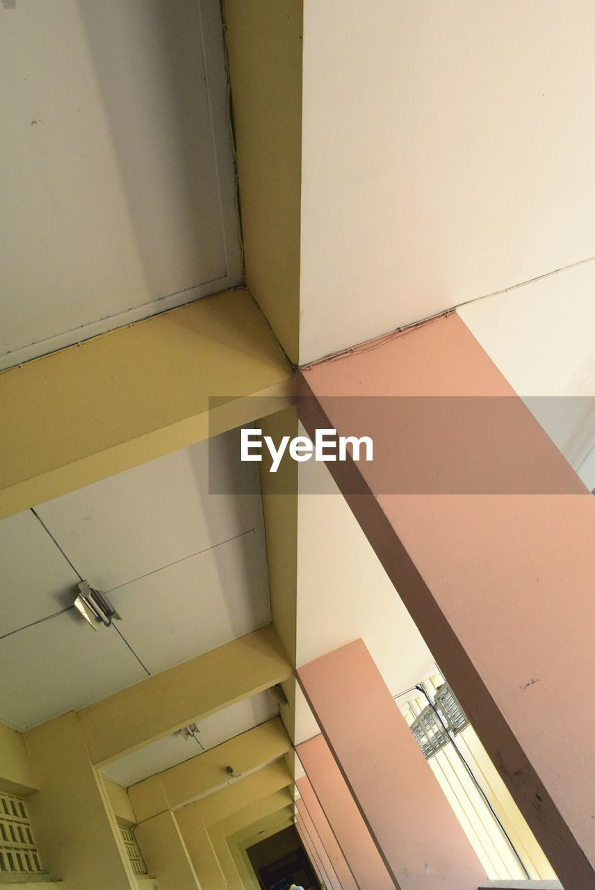 ceiling, architecture, indoors, yellow, built structure, no people, day