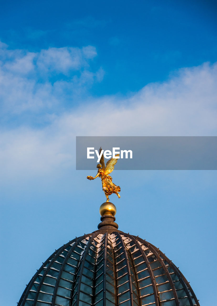 Golden Angel Statue On Dome Against Sky