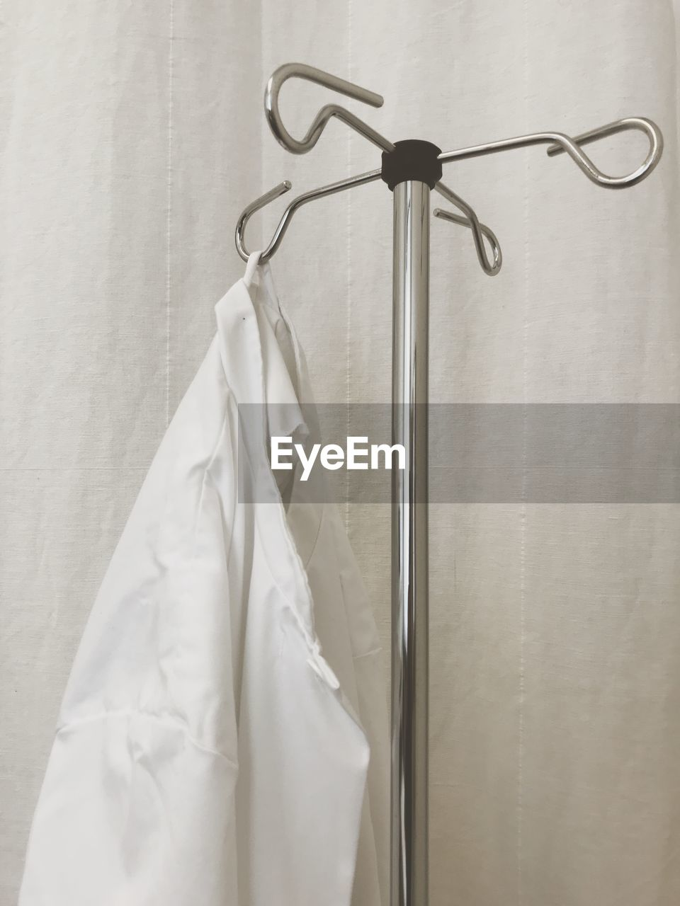 Close-Up Of Lab Coat Hanging On Rack