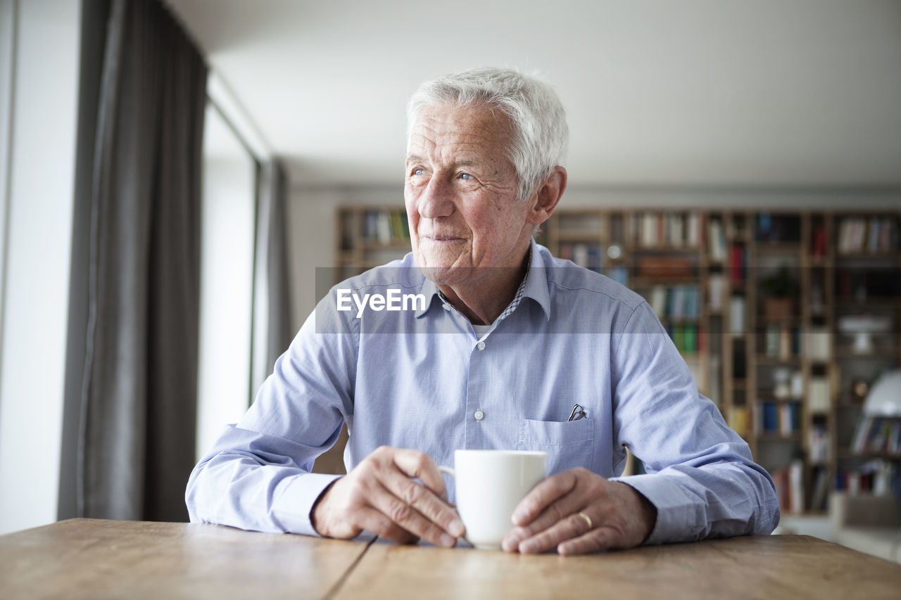 PORTRAIT OF A MAN DRINKING COFFEE CUP