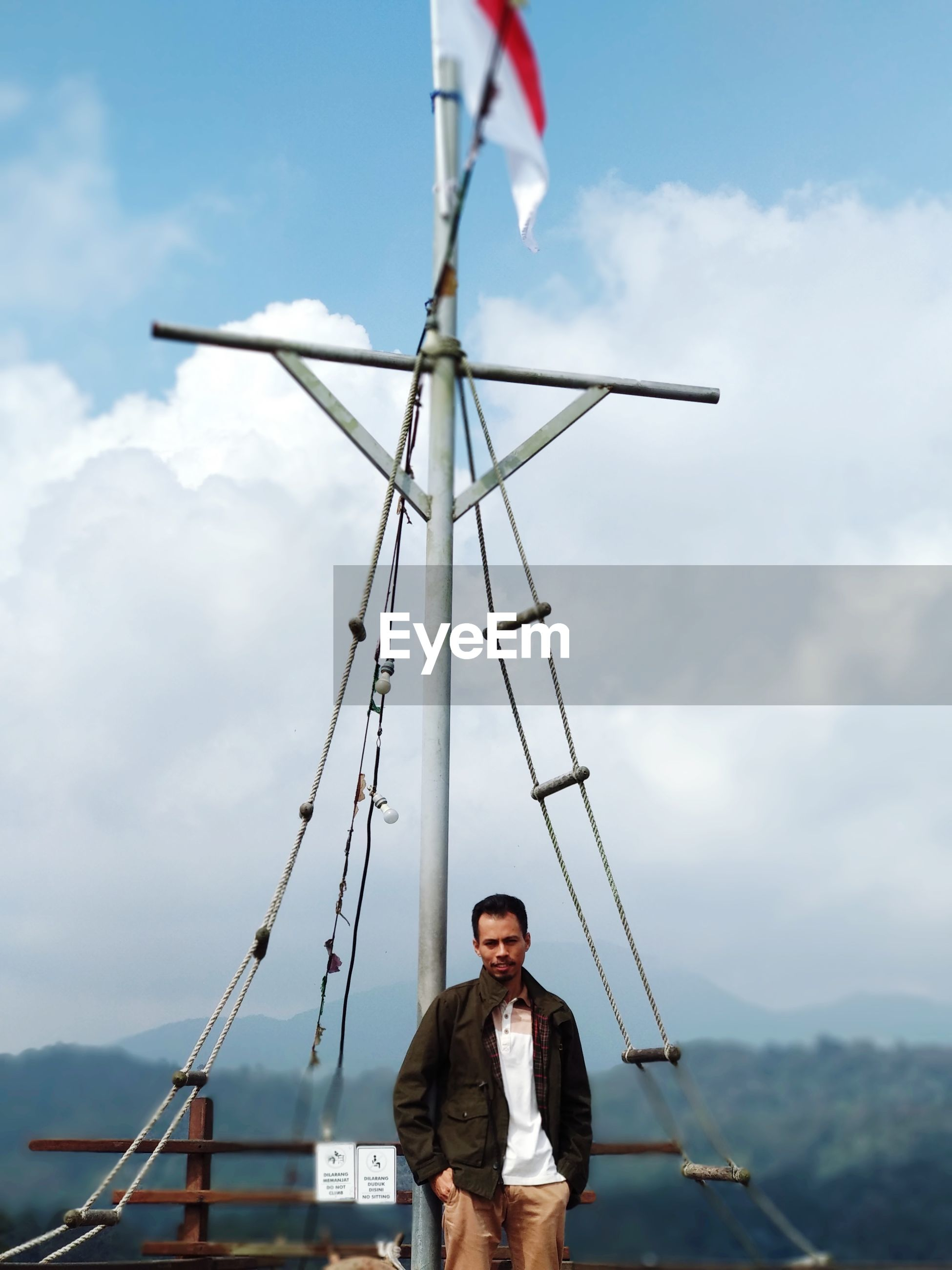 Man standing on boat against sky