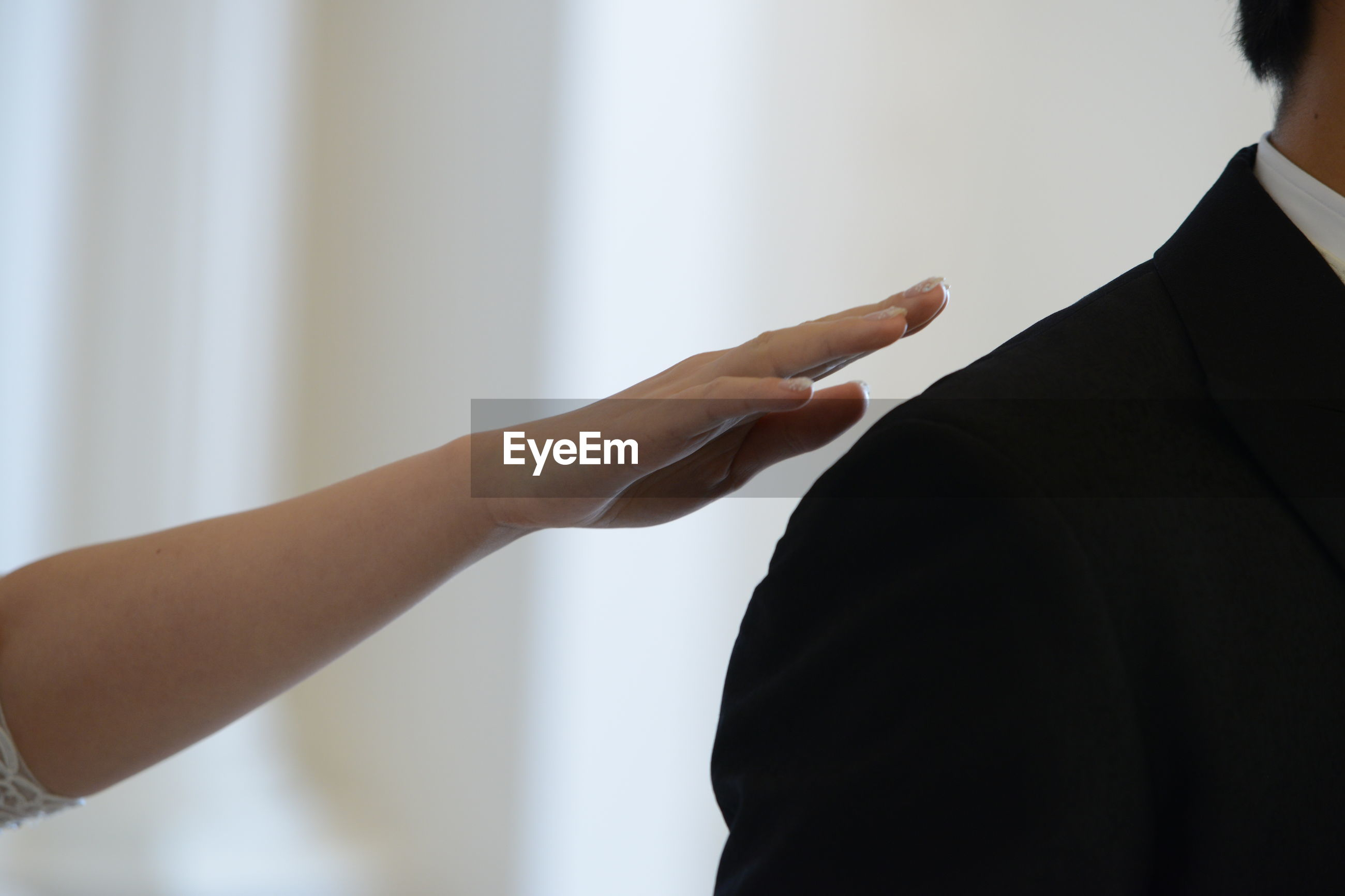 Cropped hand of woman reaching out for man