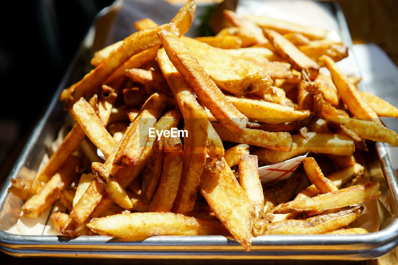 Close-up of french fries in tray