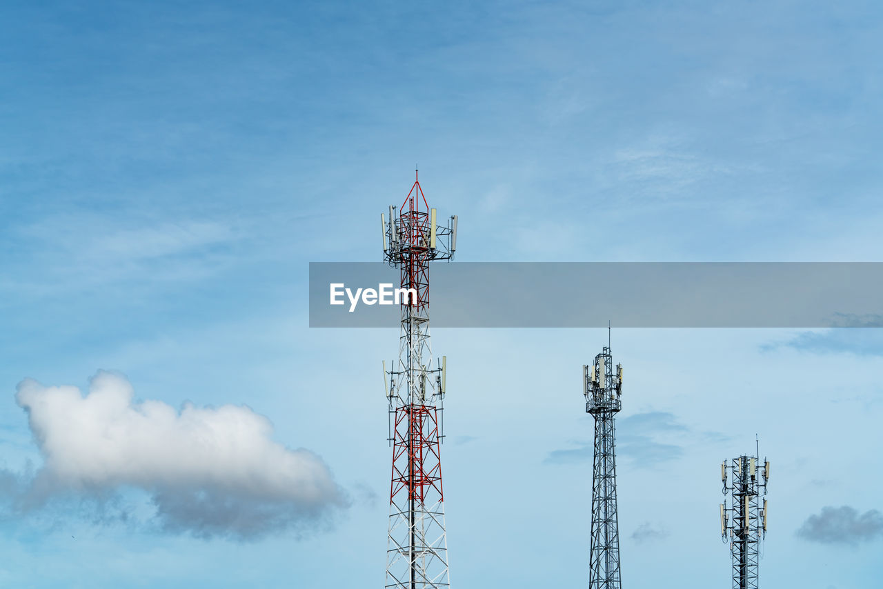 Telecommunication tower with blue sky and white clouds. antenna on blue sky.