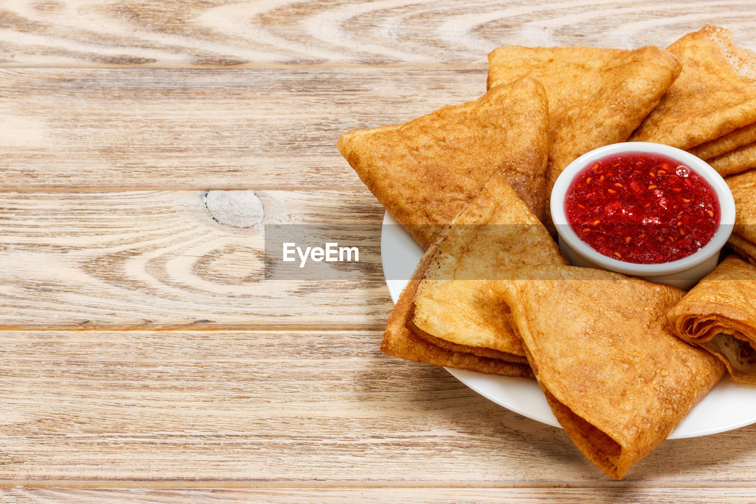 High angle view of food and sauce on table