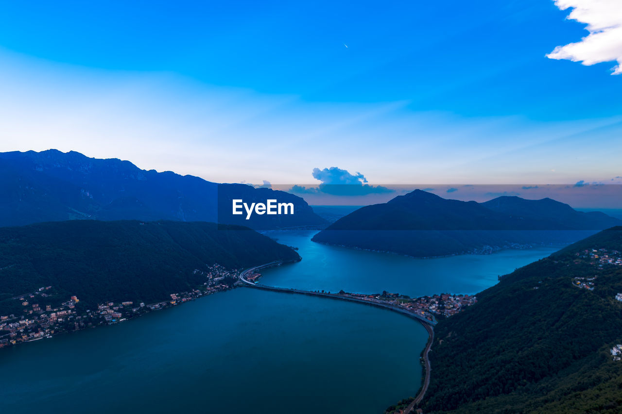 mountain, scenics - nature, beauty in nature, sky, water, tranquil scene, cloud - sky, mountain range, tranquility, nature, no people, idyllic, blue, non-urban scene, day, outdoors, architecture, high angle view, environment
