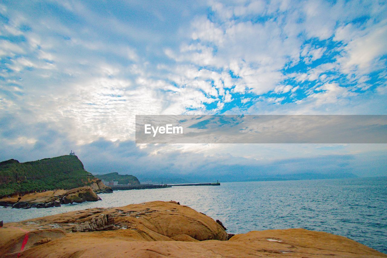 sky, water, cloud - sky, sea, scenics - nature, beauty in nature, tranquility, tranquil scene, land, beach, nature, horizon over water, idyllic, horizon, rock, day, non-urban scene, no people, nautical vessel, outdoors