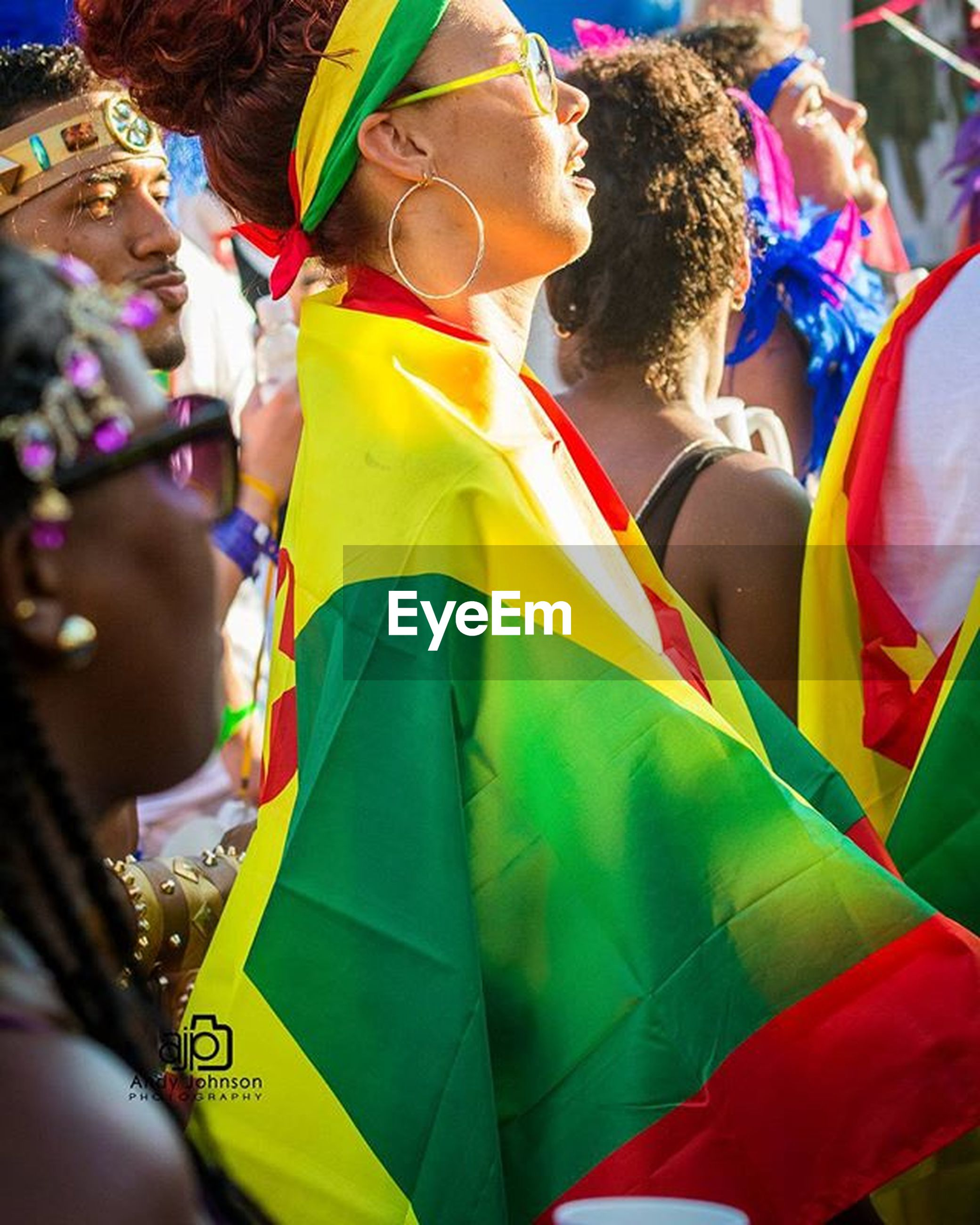 large group of people, leisure activity, lifestyles, celebration, men, person, multi colored, crowd, arts culture and entertainment, enjoyment, fun, event, outdoors, day, cultures, focus on foreground, close-up, medium group of people, incidental people