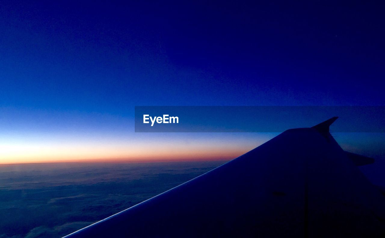 blue, airplane, no people, nature, sky, scenics, outdoors, flying, airplane wing, air vehicle, aircraft wing, landscape, beauty in nature, day, clear sky, close-up