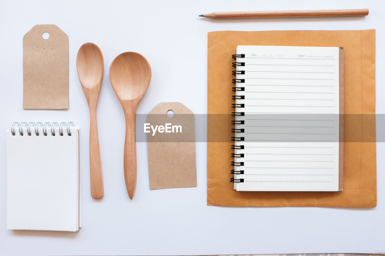 Directly above shot of various objects on white background