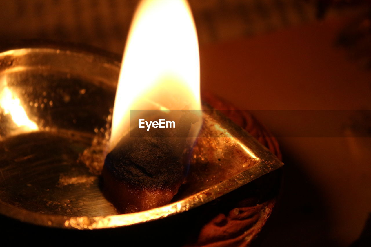 fire, flame, burning, heat - temperature, fire - natural phenomenon, illuminated, glowing, close-up, indoors, oil lamp, nature, selective focus, no people, lighting equipment, candle, orange color, dark, diya - oil lamp, focus on foreground, celebration, electric lamp, luminosity