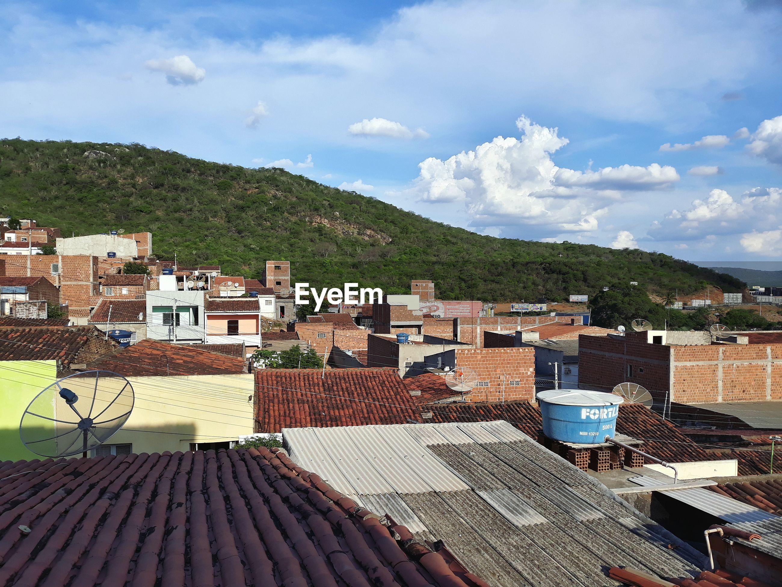 Buildings in town against sky