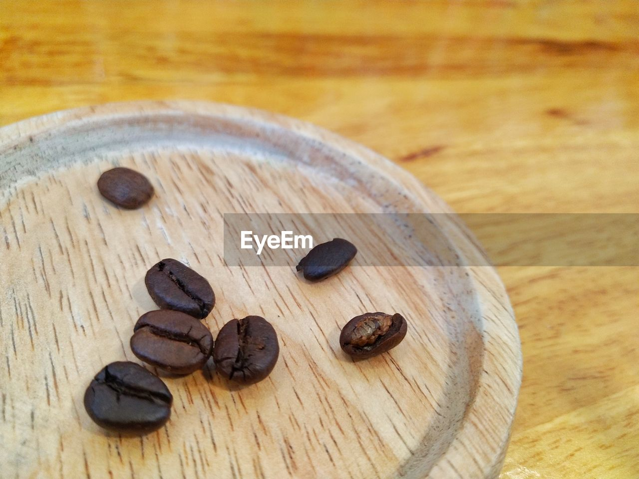 food, still life, food and drink, table, wood - material, indoors, close-up, freshness, brown, no people, focus on foreground, high angle view, roasted coffee bean, healthy eating, wellbeing, coffee - drink, nut - food, nut, coffee, group of objects, caffeine