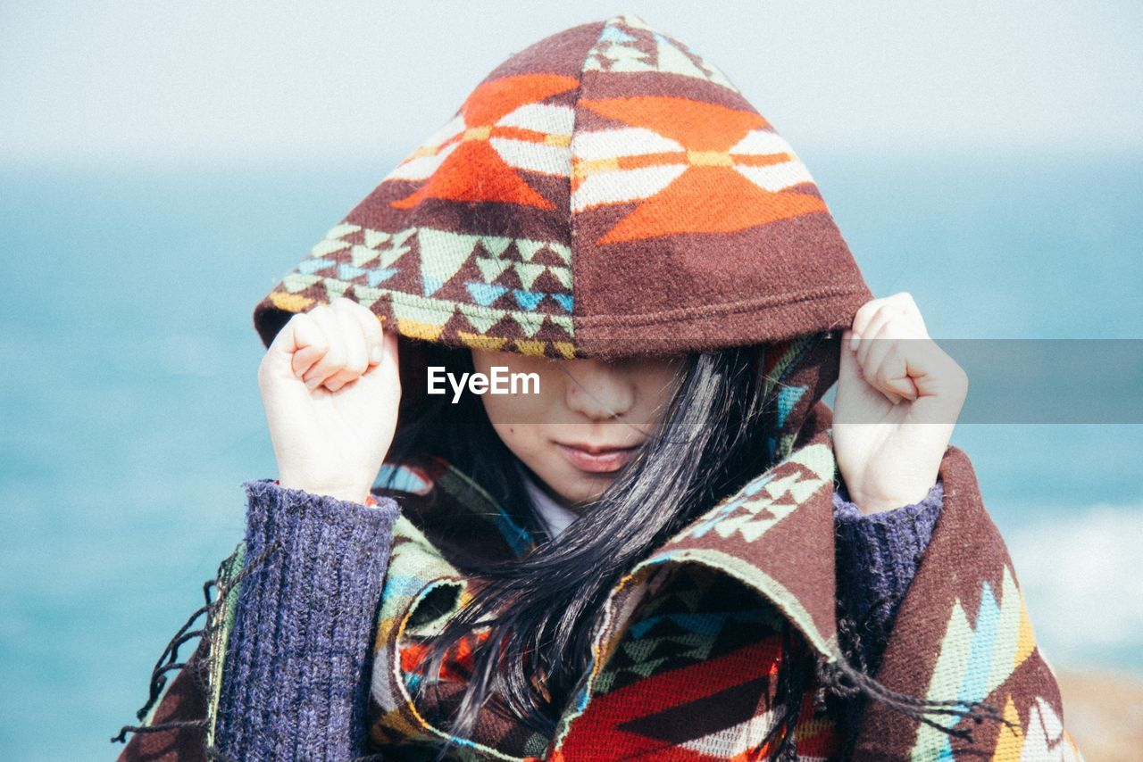 Close-Up Of A Young Woman In Hood Jacket