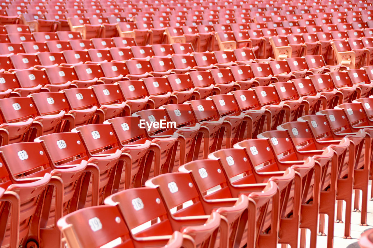 Full Frame Shot Of Empty Chairs In Statium