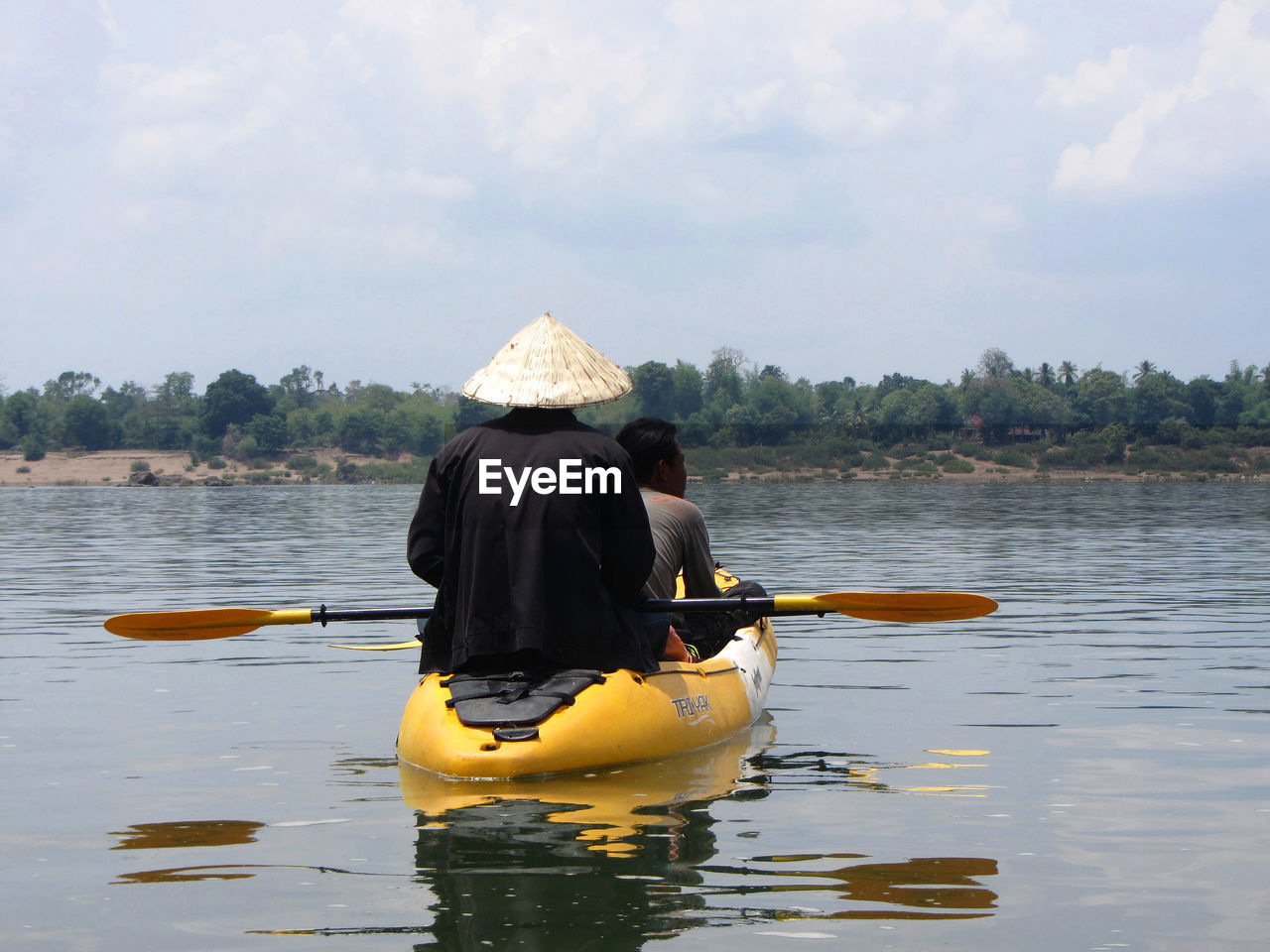REAR VIEW OF Two Men In Kayak