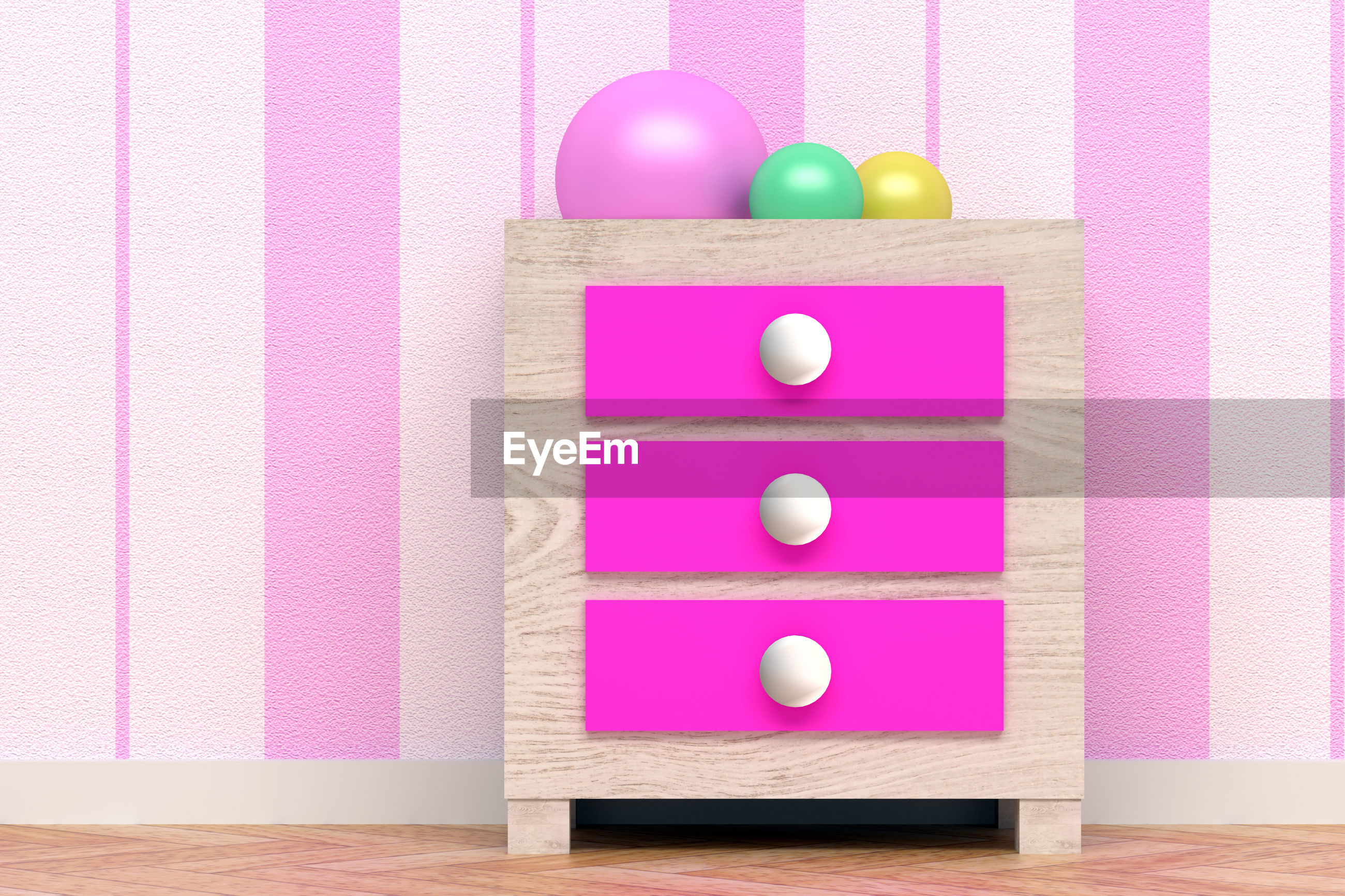 High angle view of multi colored balls on cabinet