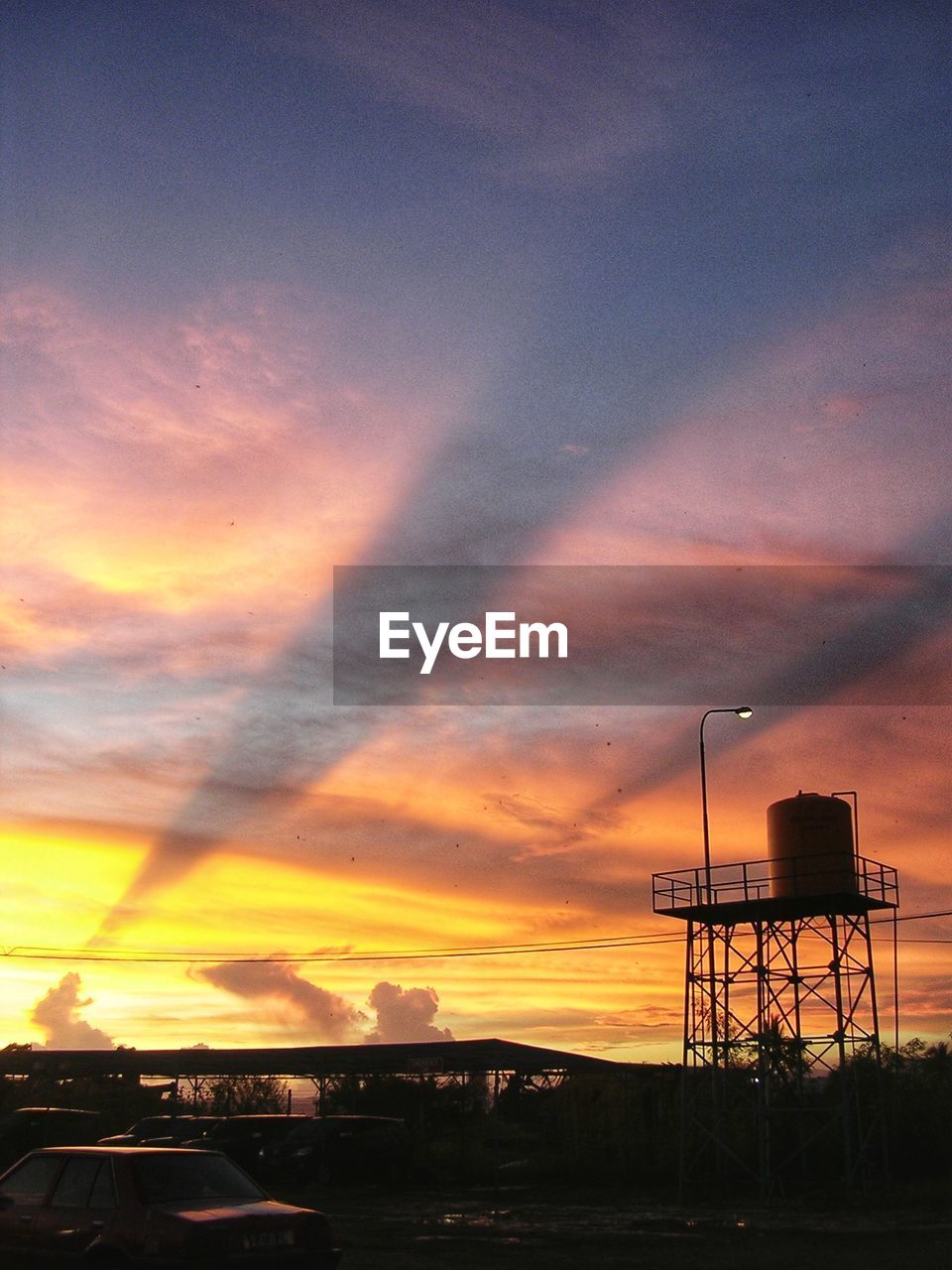 sunset, sky, cloud - sky, architecture, built structure, orange color, building exterior, nature, no people, beauty in nature, outdoors, water tower - storage tank, silhouette, dusk, storage tank, low angle view, scenics - nature, street, factory, transportation, water conservation