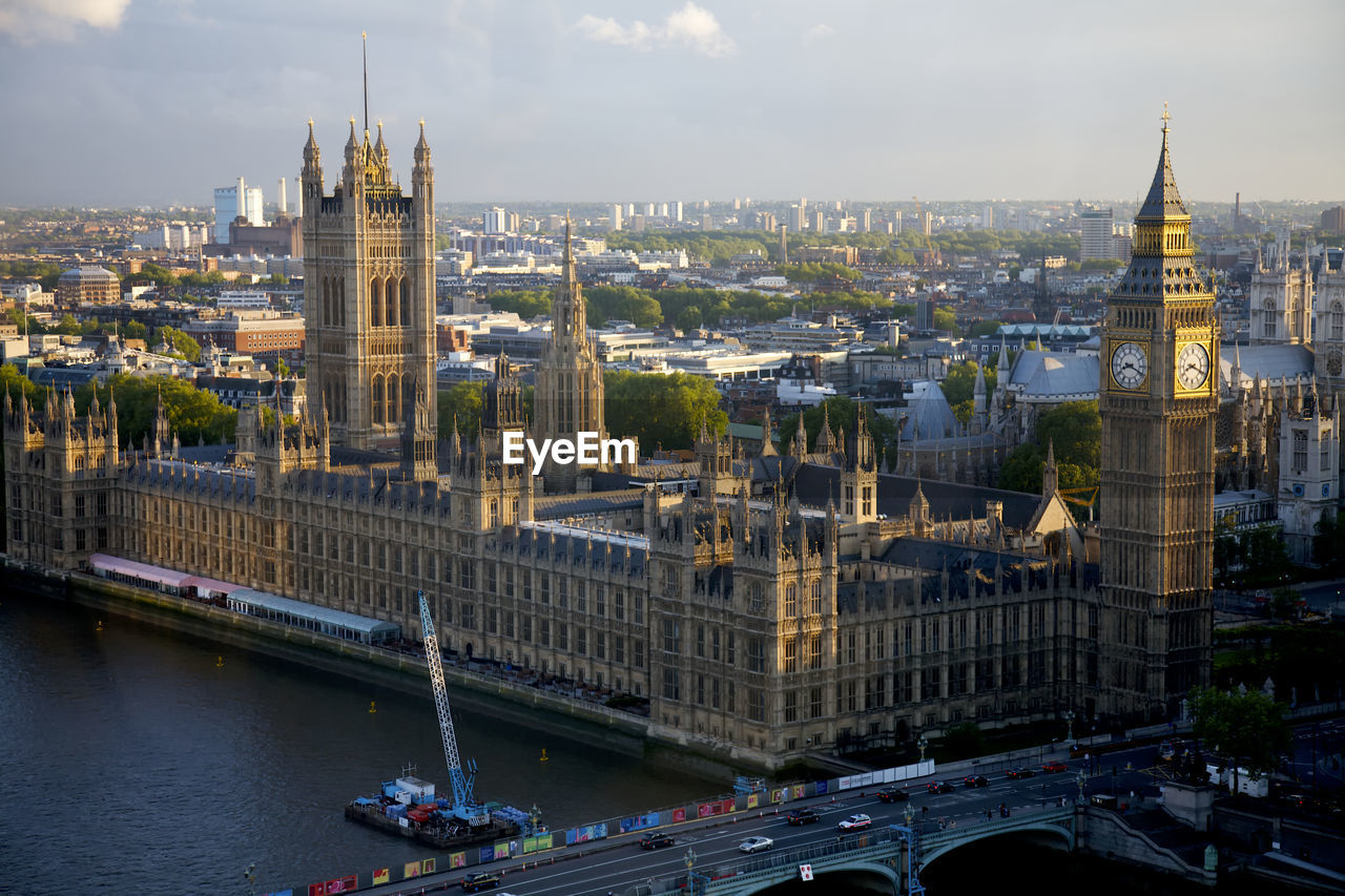 Westminster palace and bridge by thames river in city