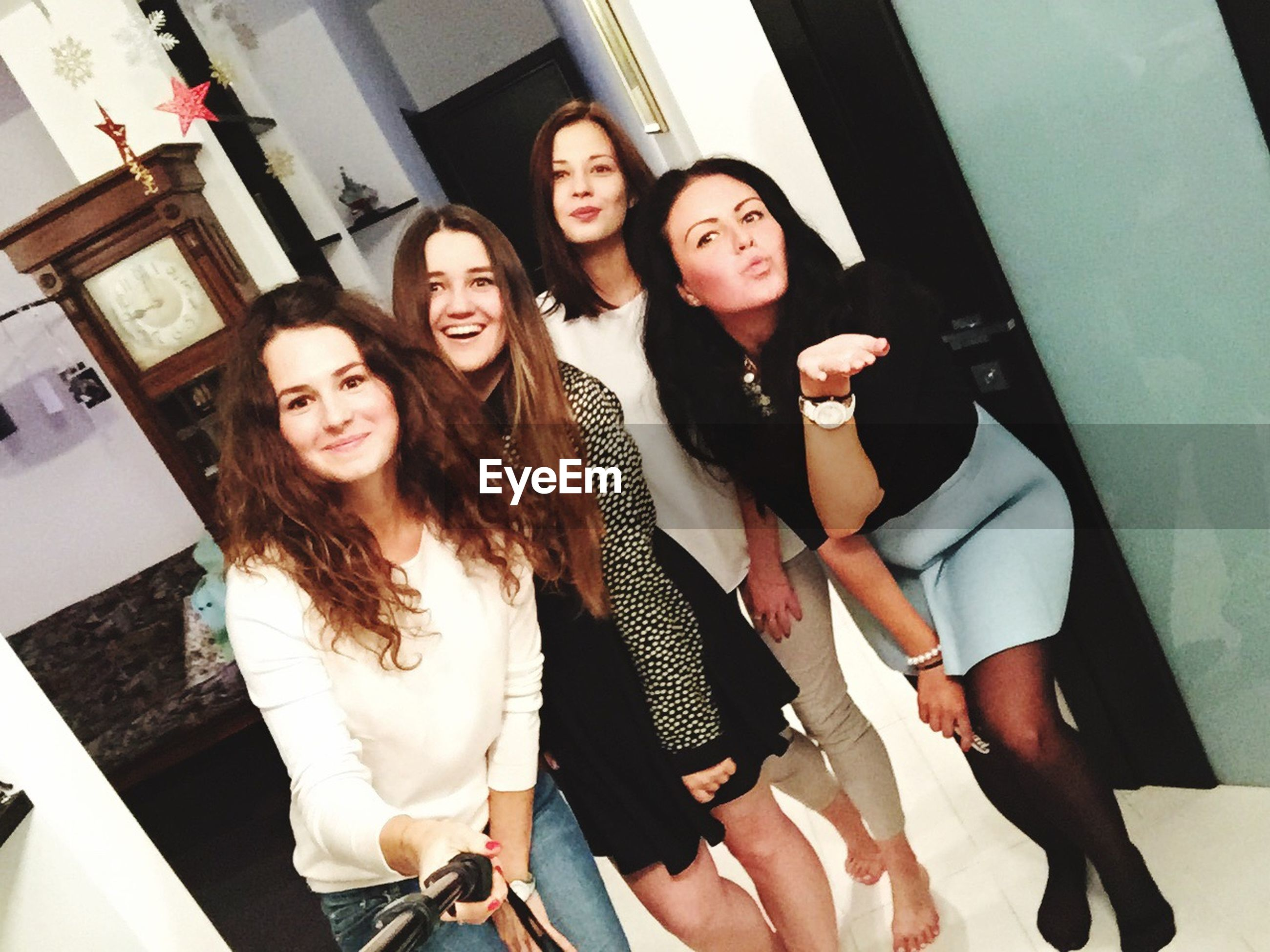 young adult, lifestyles, young women, togetherness, leisure activity, person, portrait, looking at camera, casual clothing, front view, smiling, friendship, bonding, standing, indoors, three quarter length, happiness