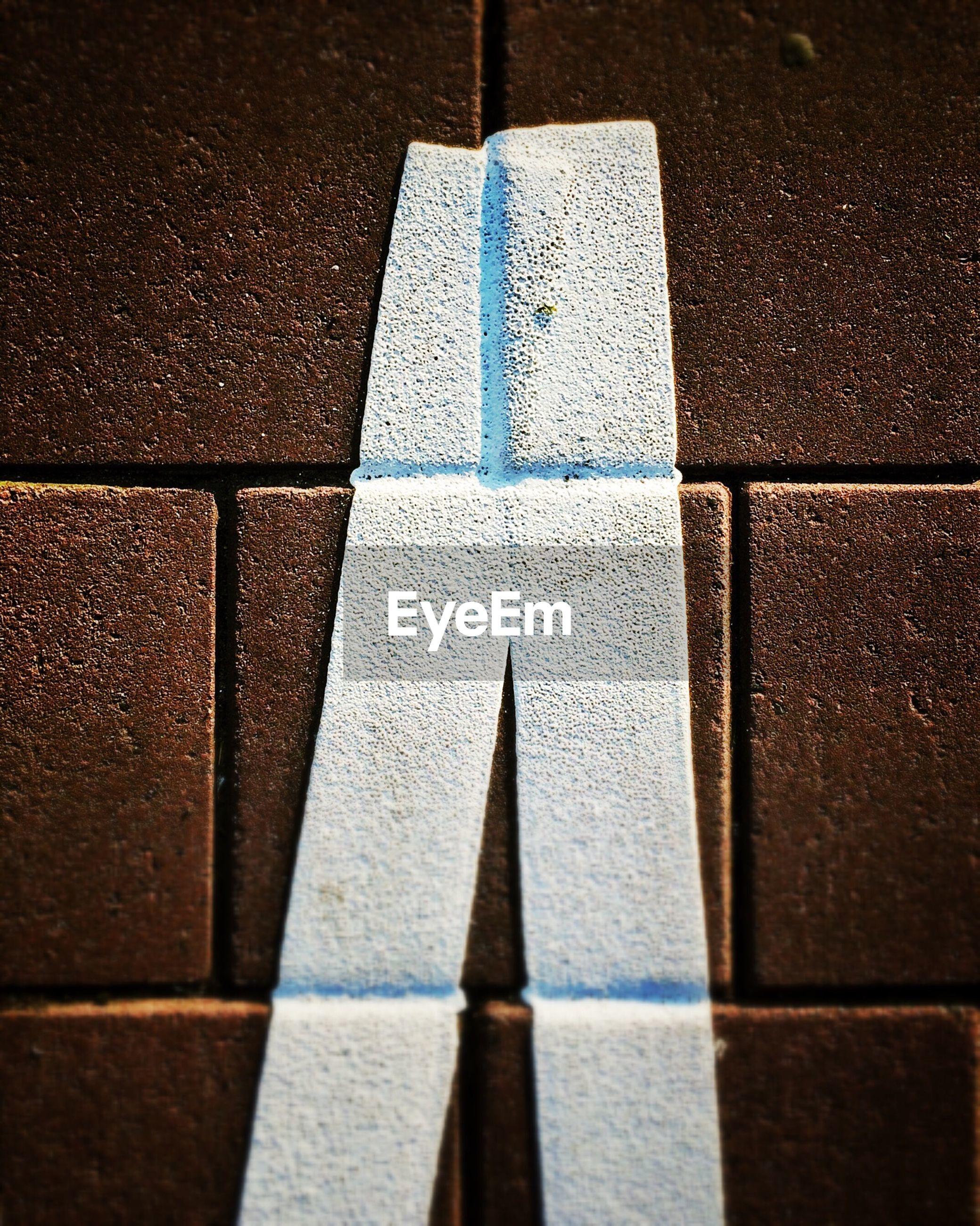 Detail shot of white line on tiled floor