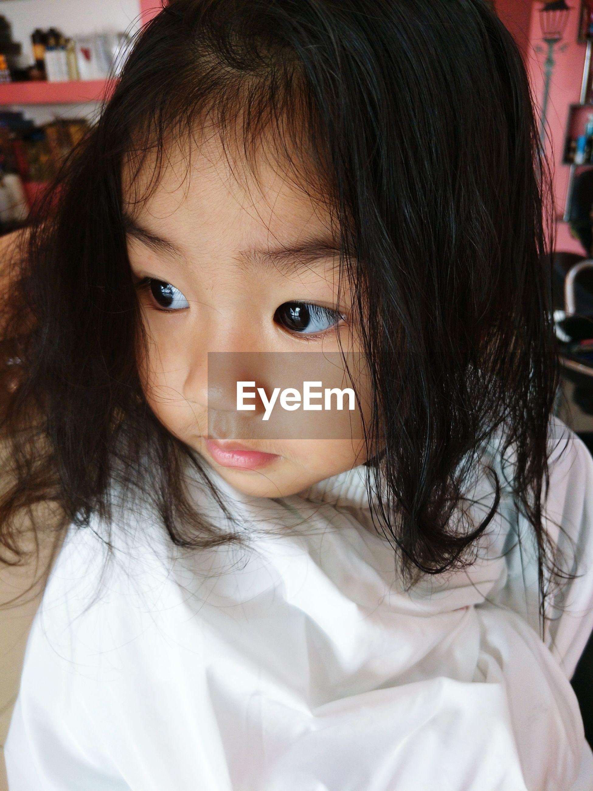 Close-up of cute girl at salon