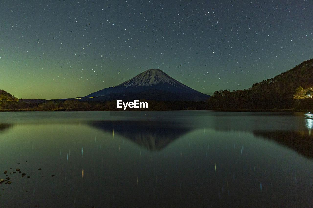 Mt. fuji and the starry sky in lake yamanaka