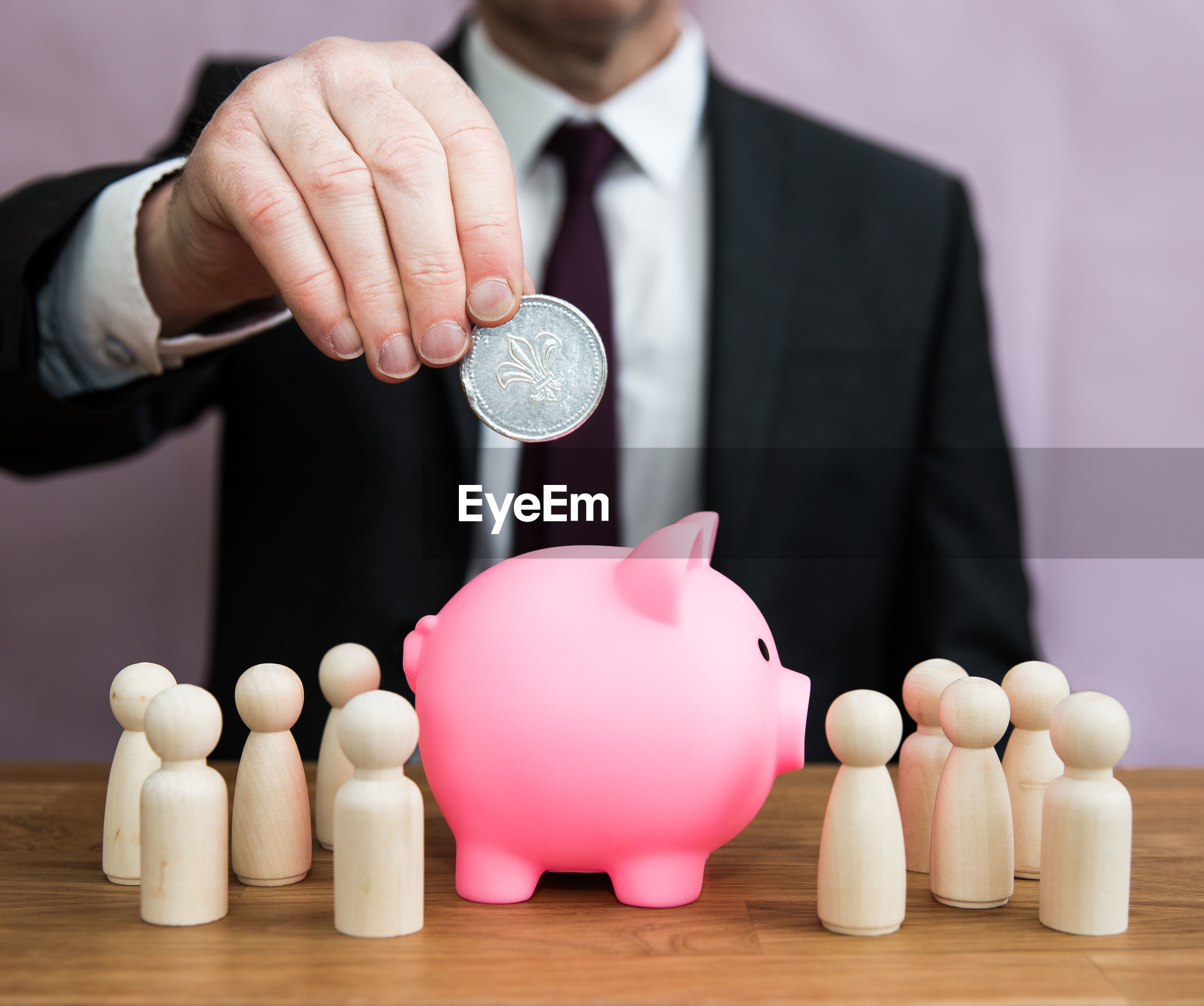 A business concept of a man paying into an employee salary, pension, tax, bonus or incentive scheme