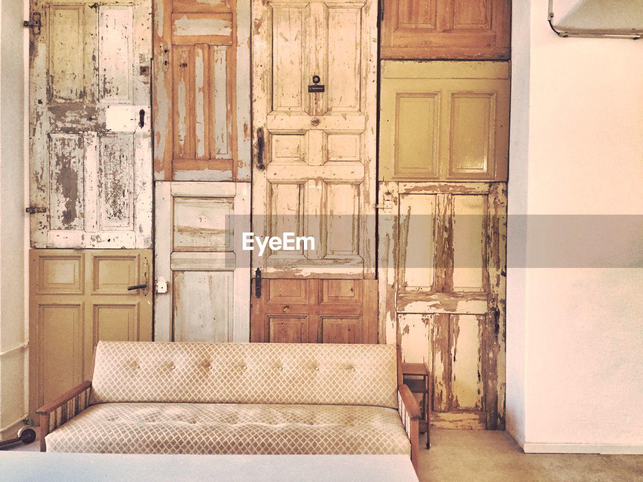 Empty sofa by closed door