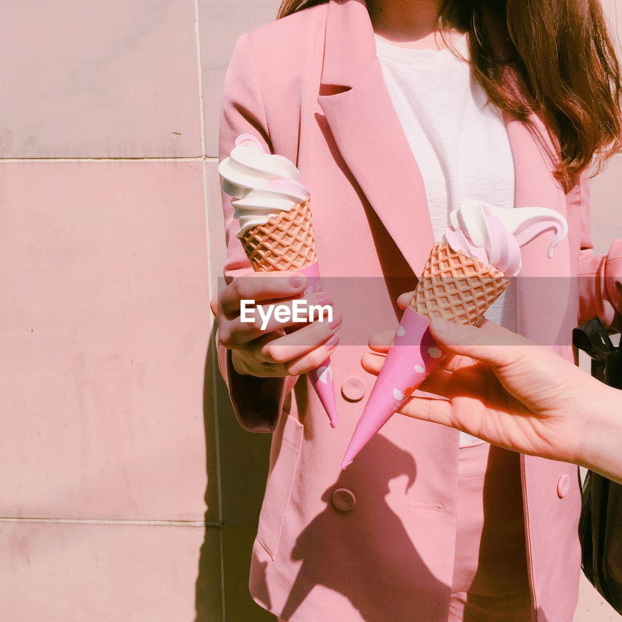 Friends Holding Ice Cream Cone