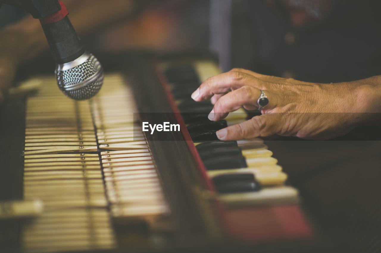 Cropped Image Of Hand Playing Harmonium