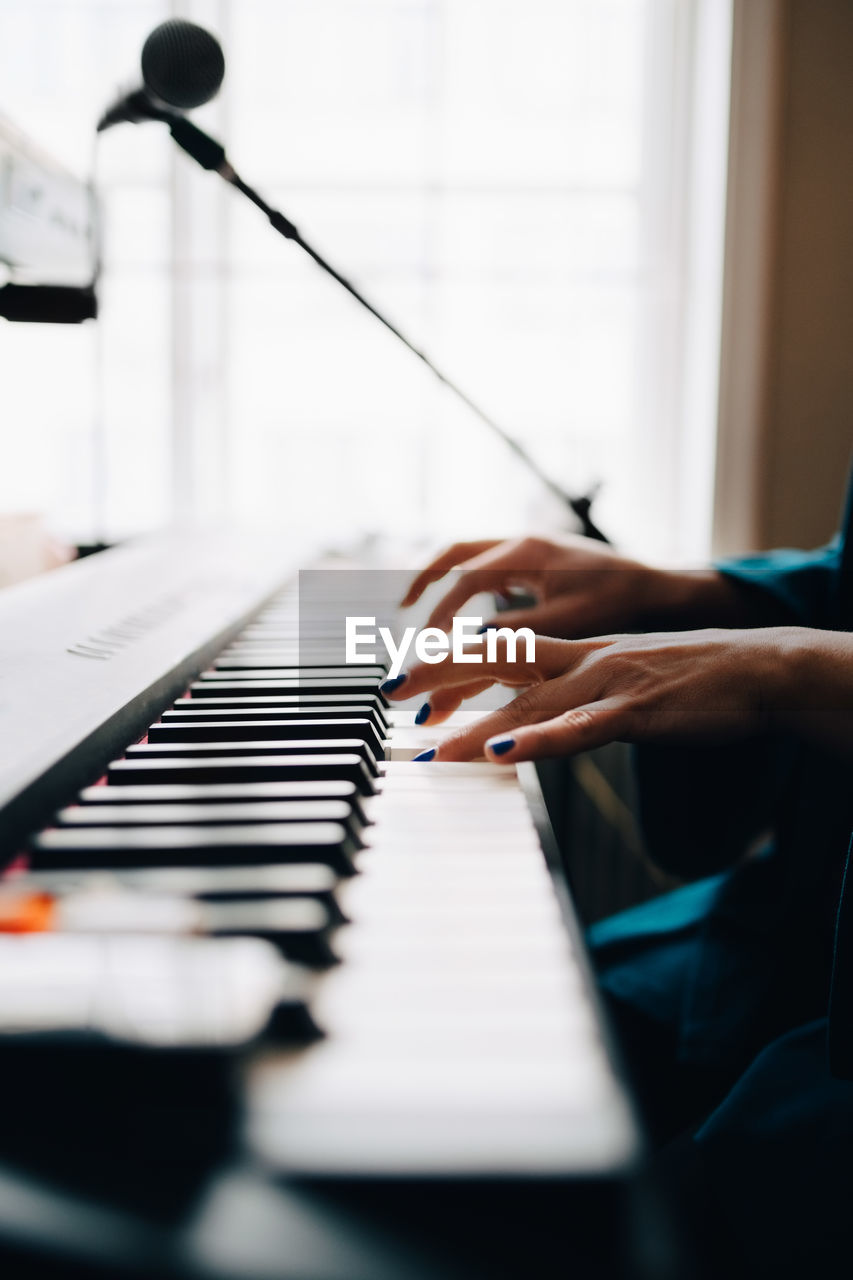 music, human hand, musical instrument, musical equipment, hand, piano, real people, human body part, one person, selective focus, playing, arts culture and entertainment, indoors, piano key, unrecognizable person, leisure activity, lifestyles, musician, finger, keyboard instrument
