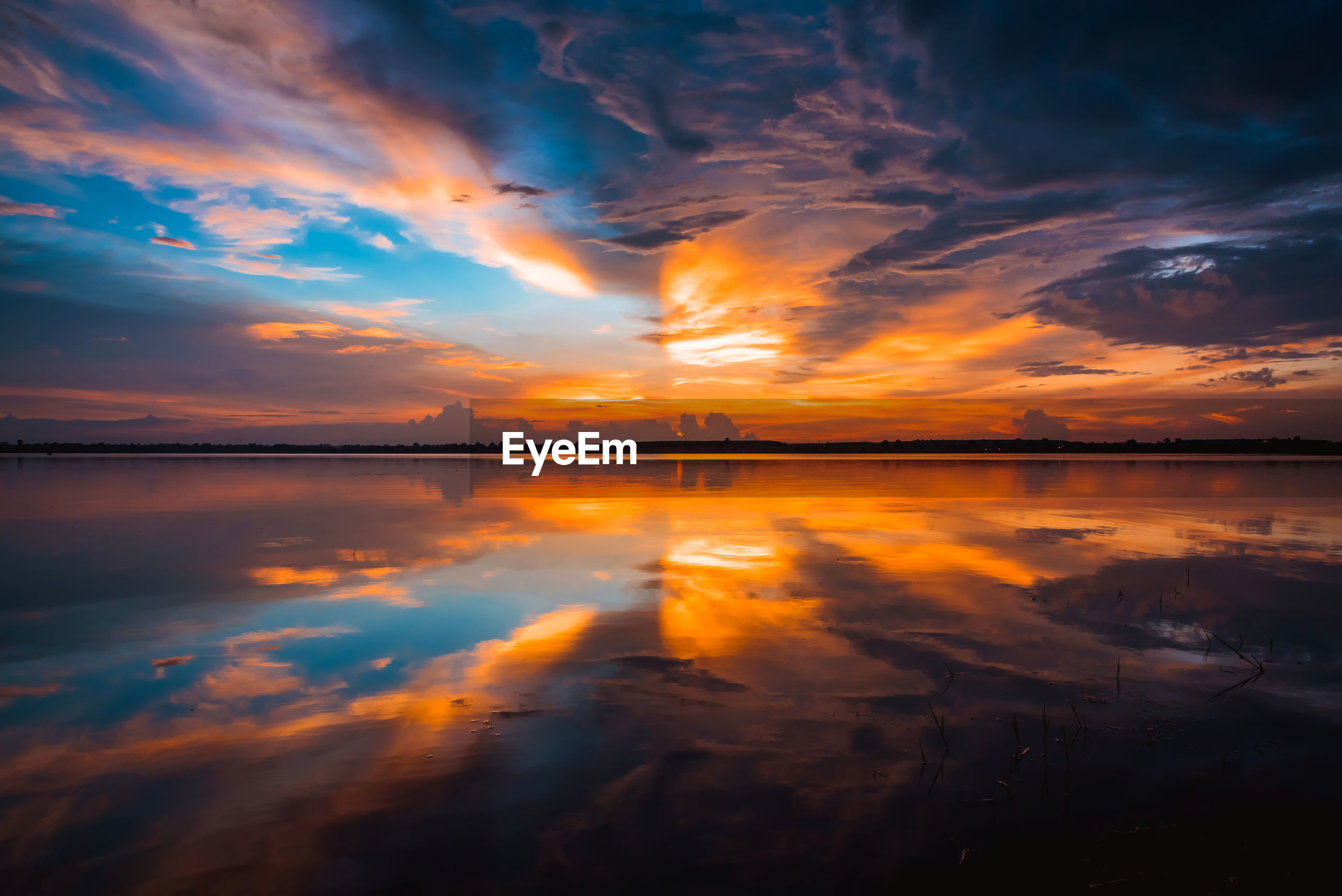 SCENIC VIEW OF SUNSET OVER WATER